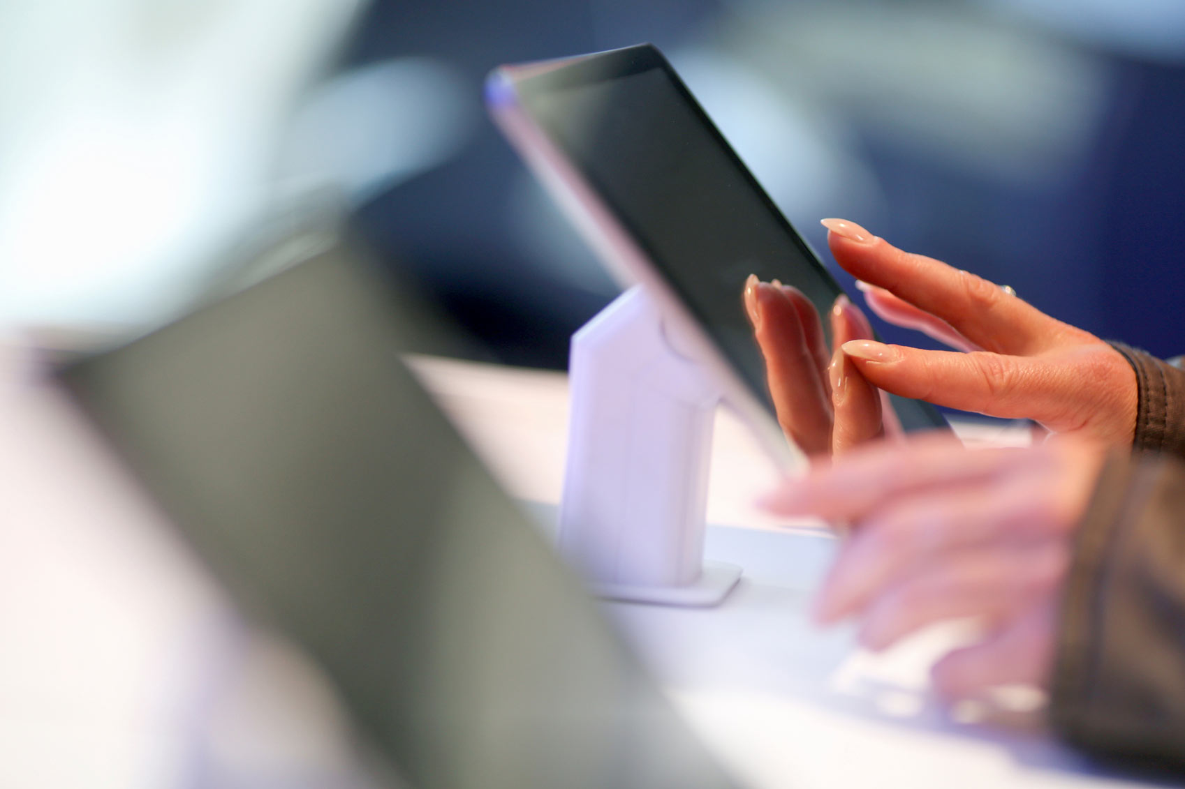 Customer filling out form on a tablet for direct mail marketing